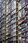 Facade of a residential,  highrise building in the middle of Hong Kong Island