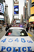 A police car of the New York City Police Department NYPD staying guard at Times Square which is located at the intersection of Seventh Avenue and Broadway,  Midtown West,  Manhattan,  New York City,  North America