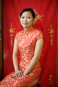 Bride wearing traditional Chinese clothing,  smiling at camera,  portrait