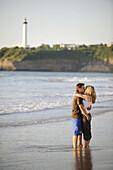 Couple kissing on beach,  Biarritz. Pyrénées-Atlantiques,  Aquitaine,  France