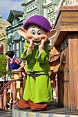 Dopey the Dwarf in parade at Walt Disney Magic Kingdom Theme Park Orlando Florida Central