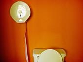 Bathroom, Bathrooms, Color, Colour, Concept, Concepts, detail, details, Hang, Hanging, Hygiene, indoor, indoors, interior, Lavatories, Lavatory, Nobody, Orange, Restroom, Restrooms, Roll, Rolls, Toilet, Toilet paper, Toilet tissue, Toilets, W C, Wall, Wal