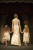 Adult, Adults, back view, Barefeet, Barefoot, Child, Children, Color, Colour, Contemporary, Dress, Dresses, Fashion, Fashion show, Female, female, Full body, Full length, Full-body, Full-length, Girl, Girls, Hand holding, Hand in hand, Hand-holding, Hold