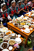 Hani Akha women drinking a toast at the Long Table Festival in Yuanyang China