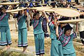 Hani Akha women and their rice sifting baskets at a festival in Yuanyang China