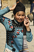 Hani woman on her cell phone in Yuanyang China