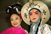 Act, Actress, Asia, China, Chinese, Costume, Couple, Dress, Make, Opera, Pose, Sichuan, Smile, Szechwan, Up, T91-811135, agefotostock