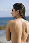 Back view of a woman by the sea