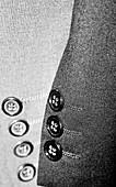 Jackets hanging in wardrobe,  detail