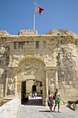 Tourists visiting the Malta at War Museum,  Vittoriosa,  Valletta,  Malta