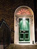 Typical Irish door in the night,  Dublin,  Ireland