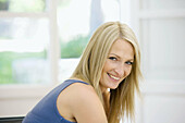Adult, Adults, At home, Blonde, Blondes, Caucasian, Caucasians, Color, Colour, Contemporary, Daytime, Facing camera, Fair-haired, Female, grin, grinning, happiness, happy, Head & shoulders, Head and shoulders, headshot, headshots, Home, human, indoor, ind
