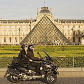 In the background The new entrance to the Musee du Louvre,  a pyramidal,  glass structure designed by renowned American architect I M Pei  Paris,  France