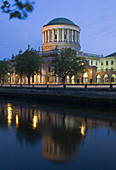 Ireland,  Dublin,  James Gandon´s Four Courts reflects in the River Liffey at dawn