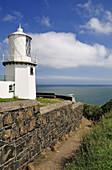 Whitehead lighthouse overlooking the irish sea
