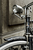 Aged, bicycle, bicycles, bike, bikes, biking, Close up, Close-up, Closeup, Color, Colour, Concept, Concepts, cycle, cycles, Daytime, detail, details, exterior, Headlight, Headlights, Metal, Old, Old fashioned, Old-fashioned, One, outdoor, outdoors, outsid