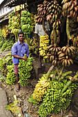 A man working at a banana shop  Kollam,  Kerala,  India