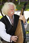 Ukraine Kiev Musician Musical instrument: Kobza