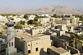 view from the historic adobe fortification Nizwa Fort or Castle,  Hajar al Gharbi Mountains,  Dhakiliya Region,  Sultanate of Oman,  Arabia,  Middle East