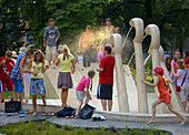 Poland,  Krakow,  Cooling off by fountain named ´Chopin´s piano´, Planty park,  summer