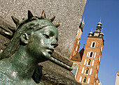 Poland,  Krakow,  Monument of great Polish poet Adam Mickiewicz,  detail and St mary´s Basilica