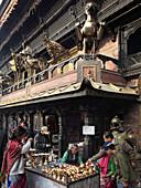 Nepal,  Kathmandu,  Indra Chowk,  Akash Bhairab shrine,  people,  butter lamp offerings