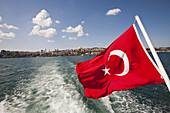 Turkey's national flag on boat, harbour, Istanbul, Turkey