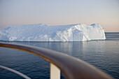 Railing of cruise ship MS Deutschland and icebergs from Ilulissat Kangerlua Icefjord at dusk, Ilulissat (Jakobshavn), Disko Bay, Kitaa, Greenland