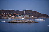 View at houses on the waterfront at dusk, Ilulissat (Jakobshavn), Disko Bay, Kitaa, Greenland
