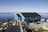 Wooden house and view at icebergs of Ilulissat Kangerlua Isfjord, Ilulissat (Jakobshavn), Disko Bay, Kitaa, Greenland