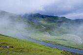 Road in the fog at highland of Streymoy Island, Faroe Islands