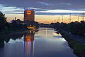 View along Rhine–Herne Canal to Gasometer in the evening, Oberhausen, North Rhine-Westphalia, Germany