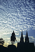 Cologne Cathedral and Hohenzollern Bridge with equestrian sculpture, Cologne, Rhine river, North Rhine-Westphalia, Germany