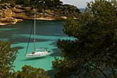 Sailing yacht in the bay, Cala de Cap Falco, Mallorca, Spain