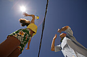 Two people playing beach volleyball, view from below, Mallorca, Balearic Islands, Spain