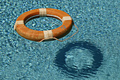Life ring floating in a swimming pool, Safety