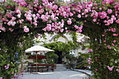 Hotel zur Linde, rose arch entrance, island of Frauenchiemsee, Lake Chiemsee, Bavaria, Germany
