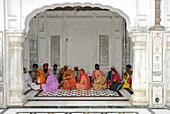 Golden Temple, Sikh holy place, pilgrims sitting in the arcades, Amritsar, Punjab, India, Asia