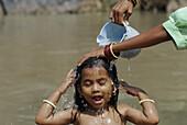 Girl bathing in a river, Bastar, Chhattisgarh, India, Asia