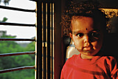 Three year old girl in a train in the morning, second class, India, Asia