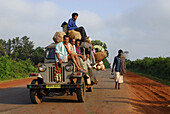People in heavy overloaded taxi jeep on their way to local market, Tribal region in Koraput district in southern Orissa, India, Asia