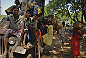 People in heavy overloaded taxi jeep on their way back from local market, Tribal region in Koraput district in southern Orissa, India, Asia