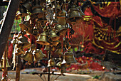 Bells at local holy site in the forest, Tribal region in Koraput district in southern Orissa, India, Asia