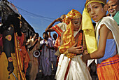 Dancing pilgrims and boys in front of the Jagannath Temple, Puri, Orissa, India, Asia