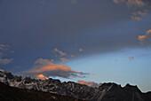 View at mountain range and clouds at sunset, Trek towards Gocha La in Kangchenjunga region, Sikkim, Himalaya, Northern India, Asia