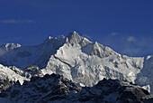 The snow covered mountain Kangchenjunga in the sunlight, Trek towards Gocha La in Kangchenjunga region, Sikkim, Himalaya, Northern India, Asia