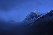 View at Mount Pandim under clouds on trek towards Gocha La at Kangchenjunga region, Sikkim, Himalaya, Northern India, Asia