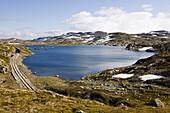 Old rails at a lake at the Rallarvegen at late summer, Hardangervidda, Norway, Scandinavia, Europe