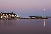 Houses at skerry coastline at sunset, Skagerrak, Sorland, Norway, Scandinavia, Europe