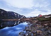 Red Norwegian house at the lake Mannsvatnet, Folgefonn peninsula, Kvinnherad, Hardanger, Norway, Scandinavia, Europe